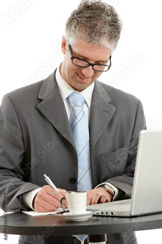 Fototapety, obrazy: Businessman writing notes