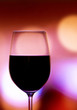 Red wine glass on a bright background