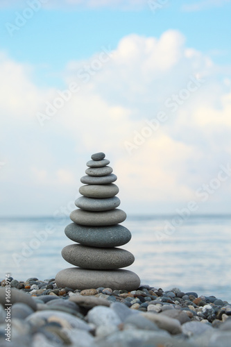 Photo Stands Zen stone stack on pebble beach