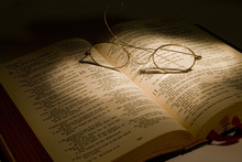 Christian Bible With Reading Glasses