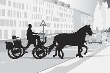 Two Horse-drawn Carriage On The Street
