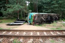 Fatal Train Crash. Derailed Locomotive Laiyng In The Woods
