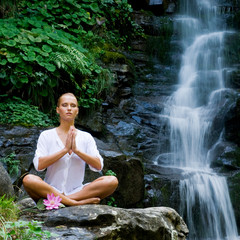 Fototapeta Do Spa Young woman doing yoga near waterfall