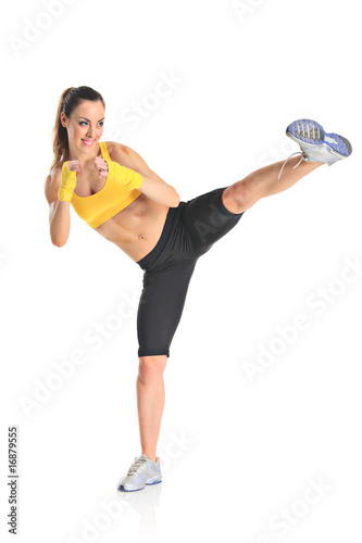 Beautiful girl kicking with the leg isolated on white Wallpaper Mural