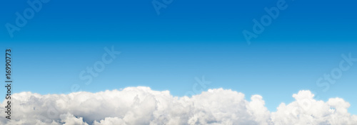 Obraz Blue sky panoramic  background with cloudscape at bottom - fototapety do salonu