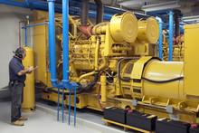 Maintenance Contractor Checking Diesel Generators