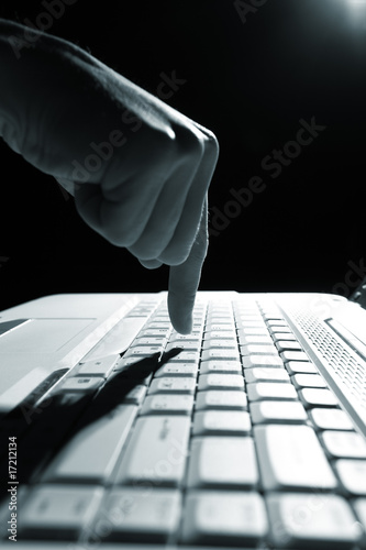 Fototapety, obrazy: male hands typing on a laptop
