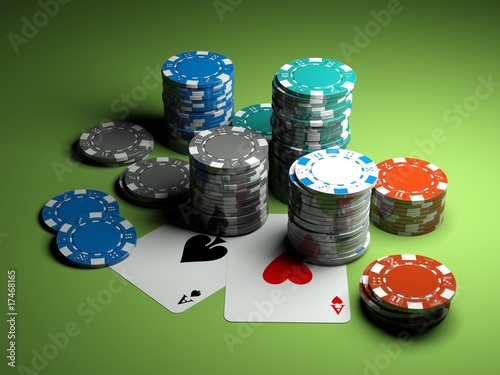 Photo  poker chips with two aces on green casino table