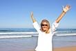 Young beautiful woman enjoying holiday at the beach