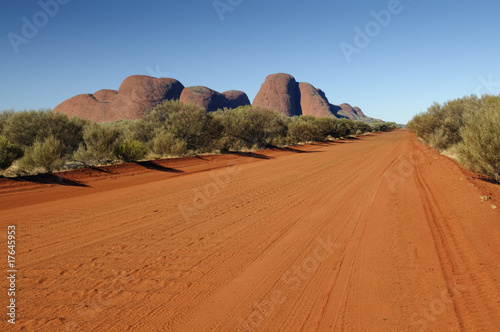 Fotobehang Australië Red dirt road in front of Olgas