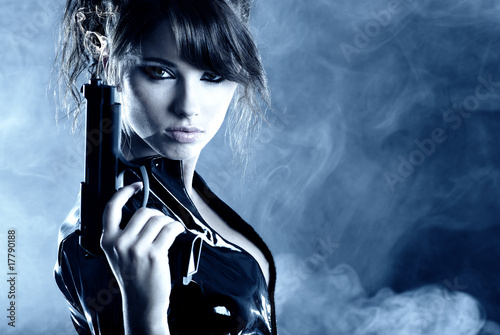 фотография  beautiful sexy girl holding gun . smoke background