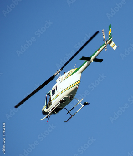 Tuinposter Helicopter Helicopter in flight