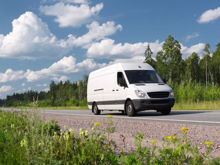 white van on rural highway, landscape