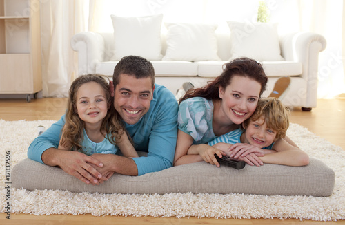 Fotografie, Obraz  Smiling family on floor in living-room