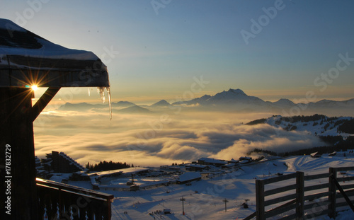 Fototapeta View of Avoriaz sunset over mist in valley