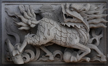 Chinese Unicorn On Temple's Wall.