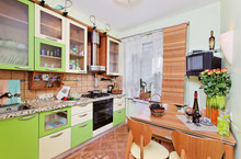 Green Kitchen Interior With Ma...