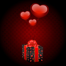 Gift With Balloons In Form Hearts On A Black Background