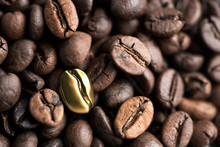 One Golden Coffee Bean With Other Coffe Beans