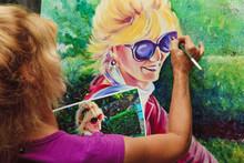 Female Artist Painting A Self Portrait