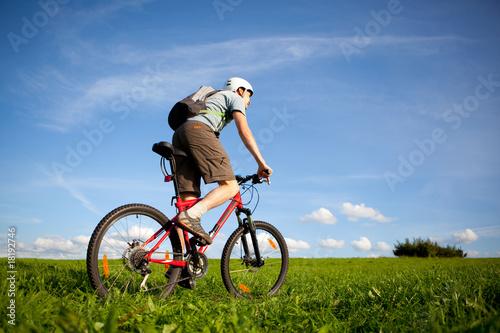 Fotobehang Fietsen Men on mountain bike.