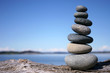 Rocks balancing on log