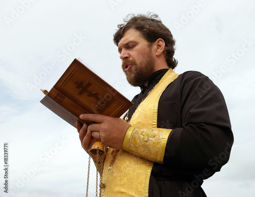 Orthodox priest reads prayer Fototapeta