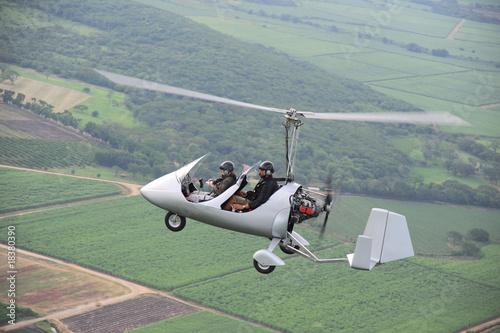 Printed kitchen splashbacks Khaki Autogyro flying over the tropical landscape