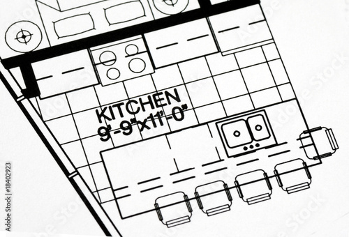 Fényképezés  A floor plan focused on the kitchen and dinning area