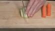 Man's hands cut onions a kitchen knife.