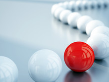 Blurred White Balls And Red Ball Is In Focus
