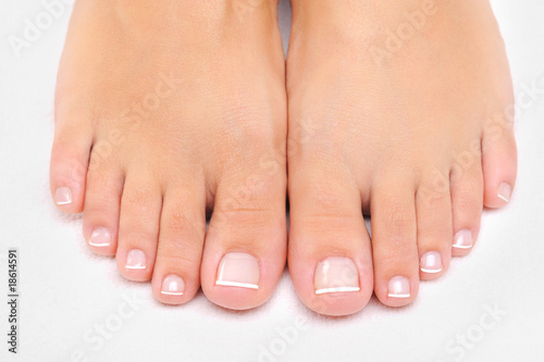 Fotobehang Pedicure female feet with the French pedicure