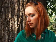 Dreaming Redheaded Girl With Interesting Makeup