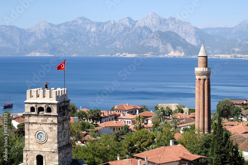 Aluminium Prints Turkey close up shot of a clock tower and minaret in Antalya