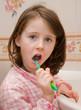 Girl brushes teeth