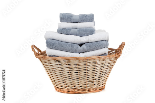 Fotografie, Obraz  Wicker laundry basket full of white and gray towels