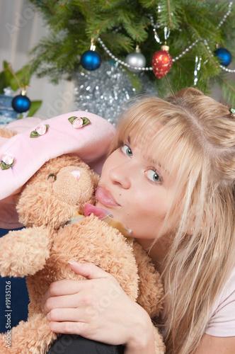Fototapeta The girl with a soft toy obraz na płótnie