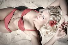 Beautiful Young Woman In Red Bikini On Beach