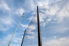 Backstop Net And Lights At Baseball Field