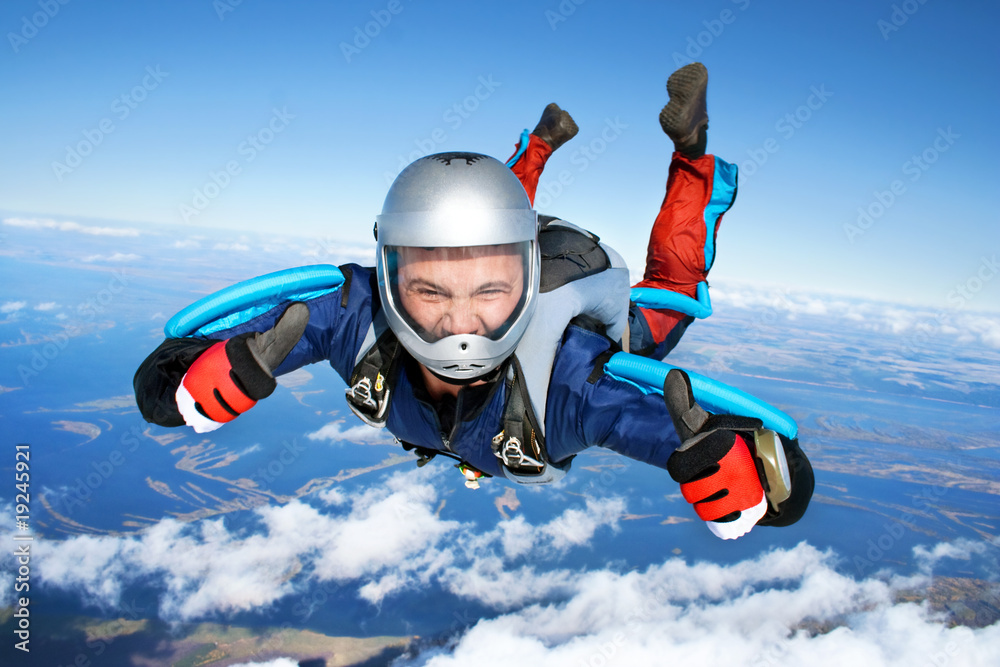Fototapety, obrazy: Skydiver falls through the air