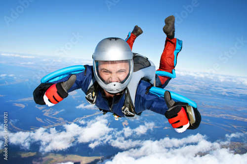 Fotografie, Obraz  Skydiver falls through the air