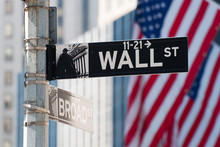 Wall Street Sign With The USA Flag