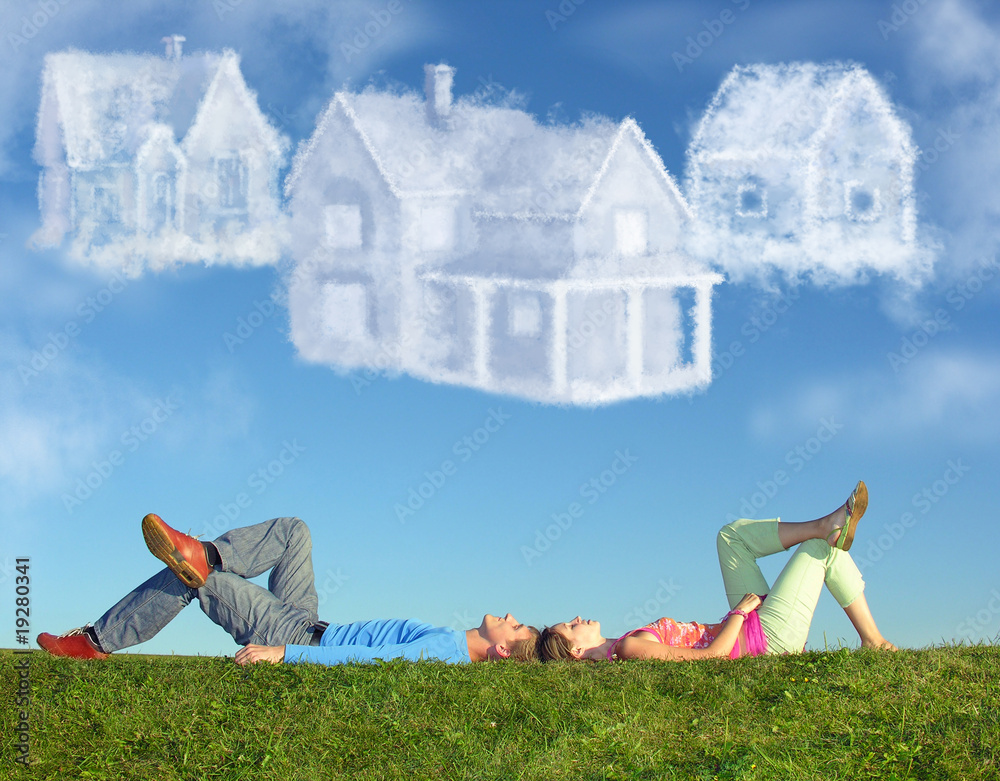 Fototapeta lying couple on grass and dream three cloud houses collage