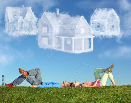 Fototapeta lying couple on grass and dream three cloud houses collage obraz