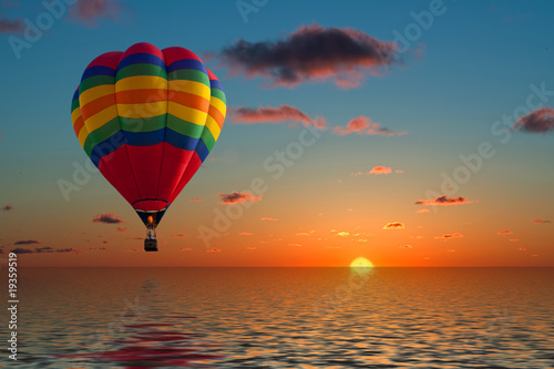 Foto op Canvas Ballon balloon flying into sunset