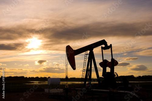 Fototapeta Pump Jack Silhouette at Sunset obraz