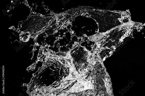 Fotobehang Fontaine Stylish water splash. Isolated on black background