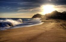 Wave On Beach With Sun Shining.