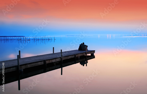 Fotobehang Pier el mar y los novios