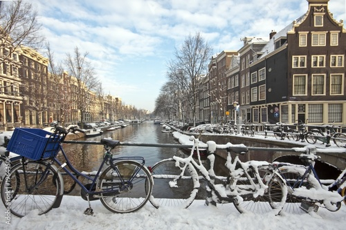 Amsterdam in the Netherlands covered with snow #19644506